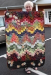 "Judy McWhorter, of Creative Quilting, displays ""Bargello Dogwood Banner,"" made for the 2012 Shop Hop Rally, Dogwood Days of Summer."