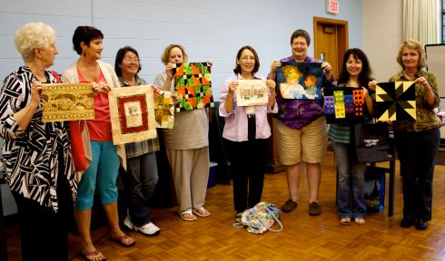 The members of the round robin, holding their centers: Judy McWhorter, Janet Price, Victoria Person, Kathy Martin, Kathy Wickham, Susan Kraterfield, Chris Epperly kindly holding Kitty DeLapp's square.