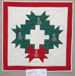 Christmas Wreath: Scrap quilt made for both daughters-in-law and one for us