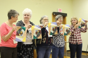 Guild members with crazy quilt samples from class