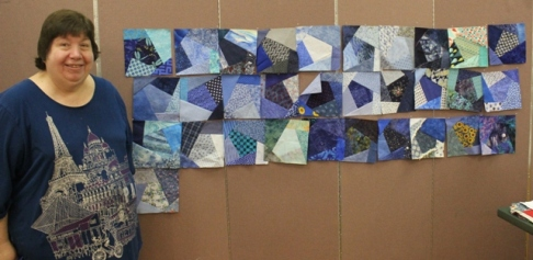 Linda Badger - winner of blue crazy pieced blocks made by members