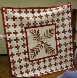 Donna Kittelson - Red and White quilt with applique center
