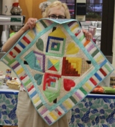 Judith Byrd - The Neighborhood quilted wall hanging