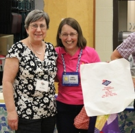 Ann Ware and Kathy Wickham with embroidered quilt label to be signed by members