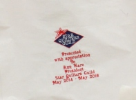 The embroidered quilt label - to be signed by members