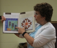 Ann Weaver - showing her quilt in the book depicting ferns in Hawaii.