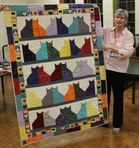 Judy Coffman - Bookend Cats quilt.