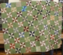 Kristin Farwig, Loretta Twiford and Guild Members - Pinwheels Comfort quilt (pinwheels pieced by members, top and binding sewn by Kristin, quilting by Loretta)