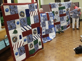 Natalie McMahon - three Christmas Vet quilts