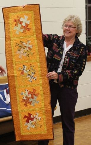 Ruth Ann Assaid - Orange Twister table runner