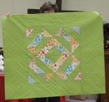 Loretta Bedia - Green half square triangle quilt.