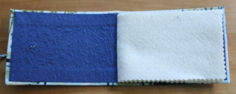 Kristin Farwig - Fabric covered needle book with inside handmade paper - made at John C. Campbell Folk School