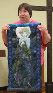 Linda Badger - Showing Barbara Badger's last quilt - 'Lady'