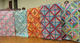 Left to Right - Cathy Russell, Loretta Bedia. ?, Judy Bradley and Marietta Price - QAYG quilts